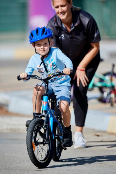 Kid learning cycling at Zayed Sports City